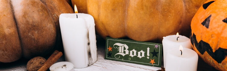 pumpkin and a sign that says Boo